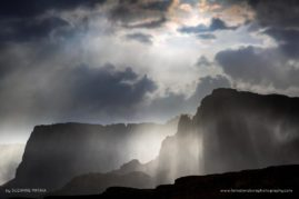 Passing Storm - A sudden and quick rainfall in the desert dances over the Vermillion Cliffs in Northern Arizona