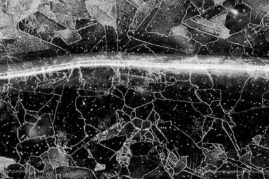 Frozen Milkyway: Detail of the pattern on a frozen heathland puddle
