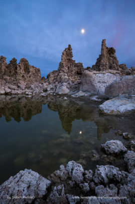 The moon rises over tufa formations at California's Mono Lake