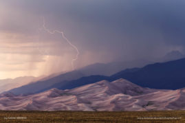 Lightning strikes during a summer storm at the Great Sand Dunes National Park in Colorado