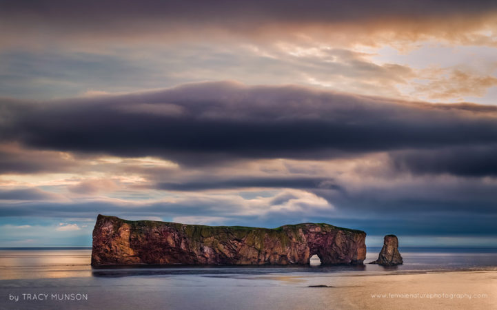 Sunrise over the pierced rock in Perce, Gaspe Peninsula, Quebec.